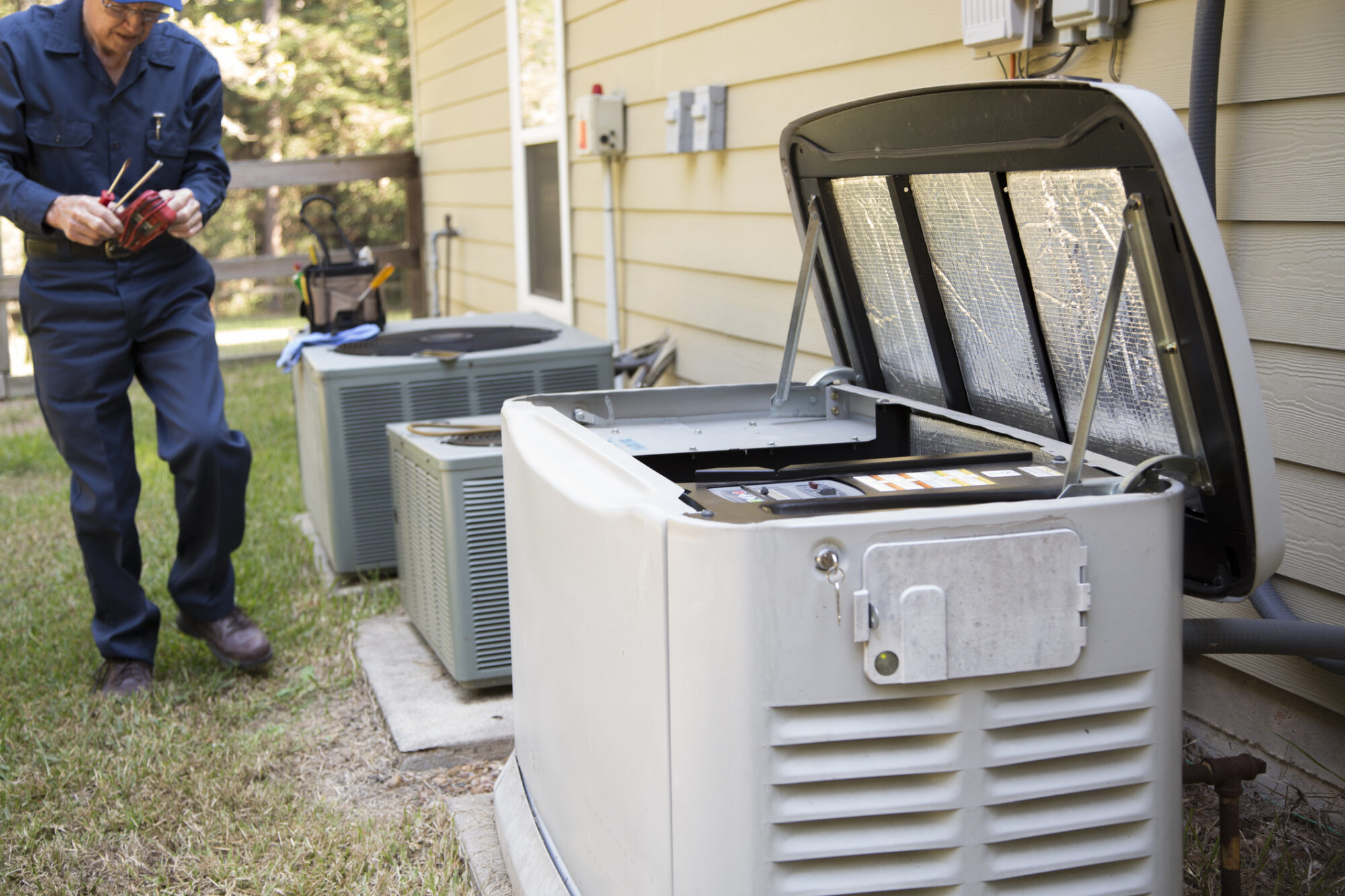 Technician services outside AC units and generator.